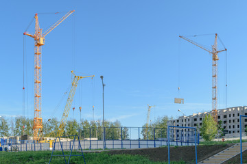 Several cranes on the construction of the house