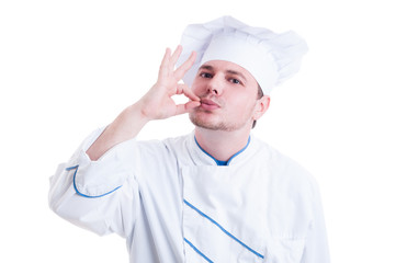 Chef or cook making tasty gesture by kissing fingers