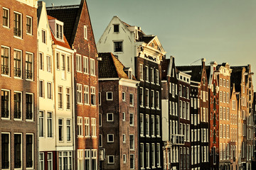 Retro styled image of ancient canal houses in Amsterdam