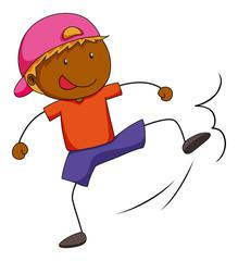 Boy doing kicking action