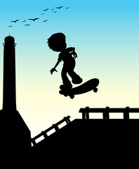 Silhouette boy skateboarding on the street