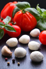 Mozzarella cheese with tomatoes and basil, caprese appetizer