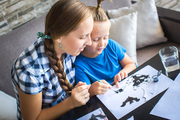 Mom with son draw a flying mouse