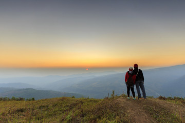 lovers of sweet looking sunrise. Phuhinrongkla National Park (Phu Lom Lo mountain), Loei ,Thailand.