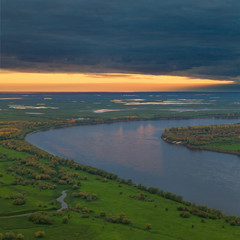 Top view of calm river in autumn evening