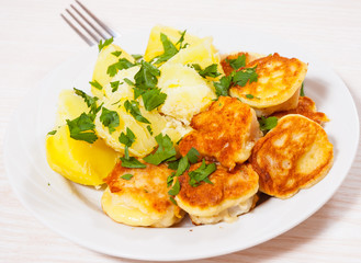 pieces of fish fillets in batter with potato