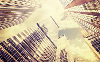 Retro stylized photo of skyscrapers in Manhattan, NYC.