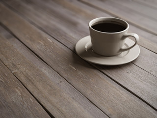 Cup of coffee on wooden boards