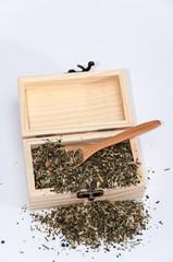 Nettle tea in a wooden box retro