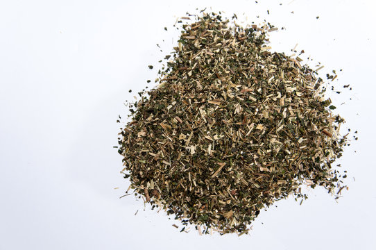 A bunch of nettle tea over white surface