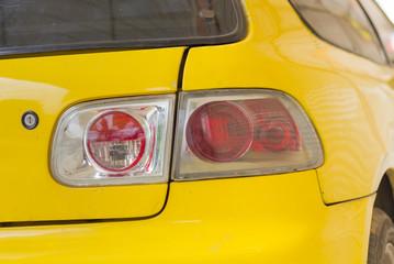 Bottom light's old yellow car