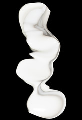 milk splash on black background