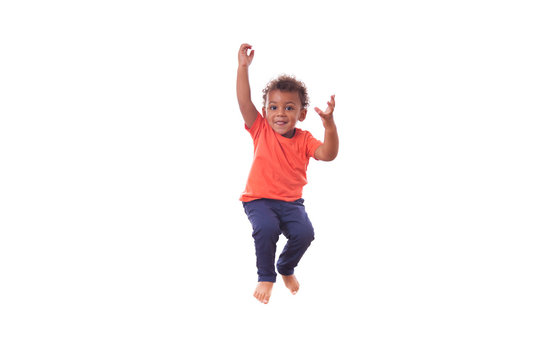Portrait of a cute little African American boy jumping on a tram