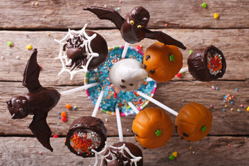 Halloween pop cakes on a table close-up. horizontal top view
