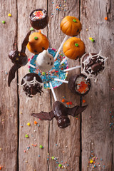Halloween pop cakes on a table. vertical top view