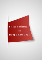 merry christmas card inserted into paper