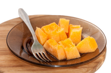 Yellow melon cut into pieces and served