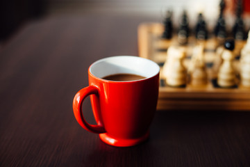 Coffee in a red cup for Chess players