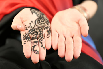 Image of henna on female hand, closeup