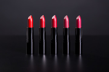 Set of bright lipsticks in shades of red color