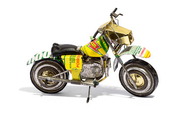 Miniature Motorcycle Model on White Background