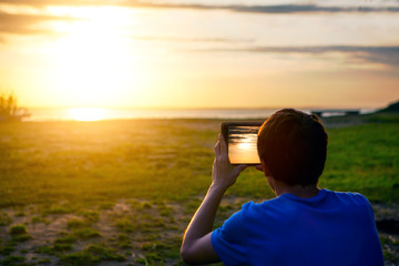 Man with Tablet at Sunset