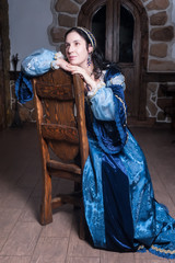 Attractive woman in blue baroque dress