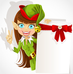 Lovely girl the Christmas elf with a banner