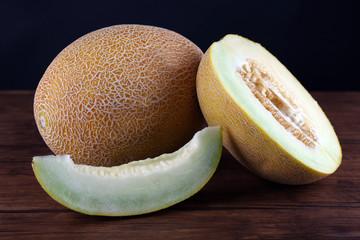 Ripe melon on dark background