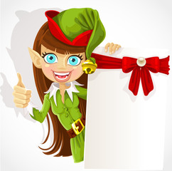 Girl the Christmas elf with a banner
