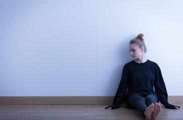 Sad teenage girl suffering
