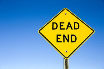 Dead End Sign Against Blue Sky