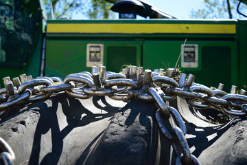 Closeup of Tire Chains on Green Log Skidder