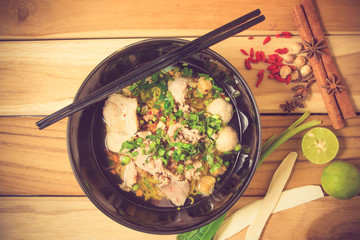 Asian style pork noodles in soup vintage color