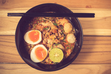 Thai noodle soup in a bowl taste spicy noodle soup and boiled eg