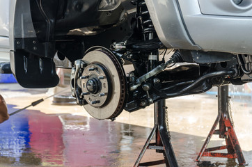 Washing pick-up suspension with water jet