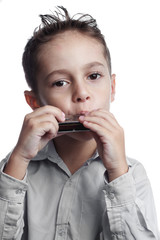 Child playing harmonica