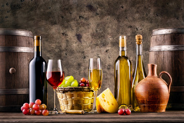 Still life with wine, grapes, barrels and cheese