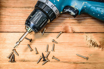 tools supplies on wood vintage background.