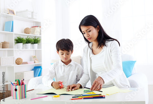 mother and son in preschool activity 91899612. Black Bedroom Furniture Sets. Home Design Ideas