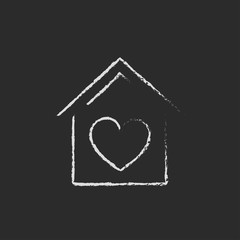 House with heart symbol icon drawn in chalk.