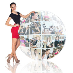 Woman stands beside collage sphere