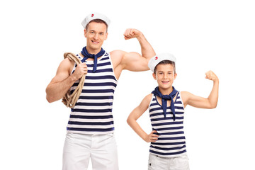 Man and a child in sailor uniforms showing biceps