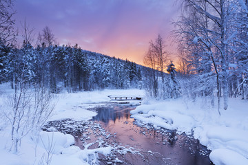 Wall Mural - Sunrise over a river in winter near Levi, Finnish Lapland
