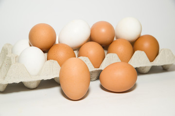 Chicken eggs of different colors in the package for sale
