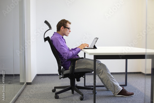 Text Neck Man In Slouching Position On Ergonomic Chair
