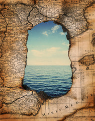Fototapete - vintage burned-down map opens a view of the sea. Ready design on the subject of adventures, pirates