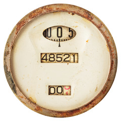 Rusted ancient speedometer isolated on white