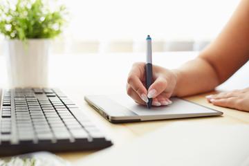 Graphic designer working on a digital tablet