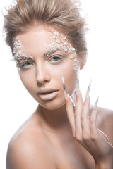 Beautiful fashion model with long nails, creative makeup and